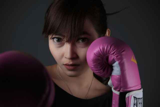 woman wearing purple boxing gloves