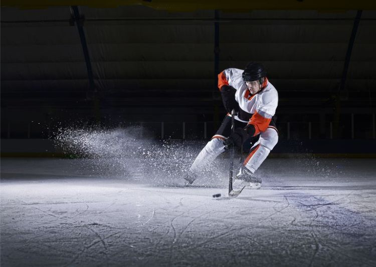 male-ice-hockey-player-taking-puck-467177485-59dfca4003f4020010076401
